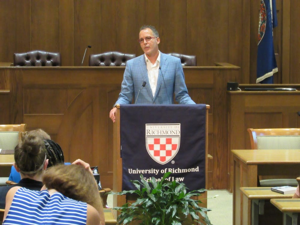 <p>Pulitzer Prize-winning author and Yale Law School professor James Forman Jr. addresses the audience during his lecture on Thursday, Sept. 12, 2019. Forman spoke at the T.C. Williams School of Law about mass incarceration and the criminal justice system.</p>