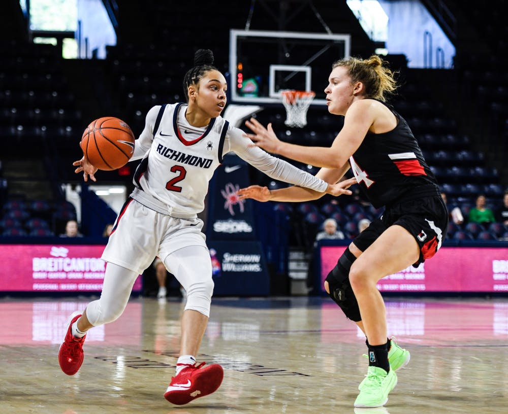 Sophomore guard Aniyah Carpenter looks to pass the ball during a game against Davidson in the Robins Center on January 26, 2020.