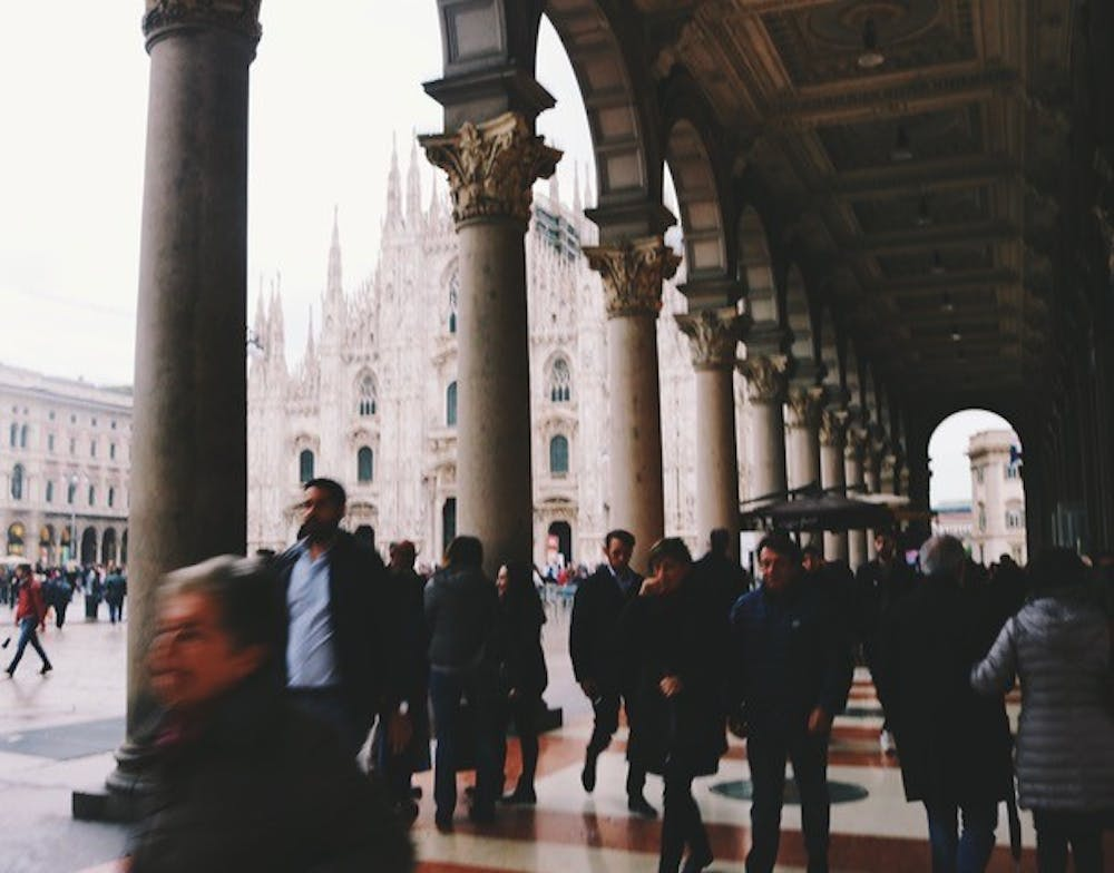 <p>A crowded sidewalk beside the Milan Cathedral.&nbsp;</p>