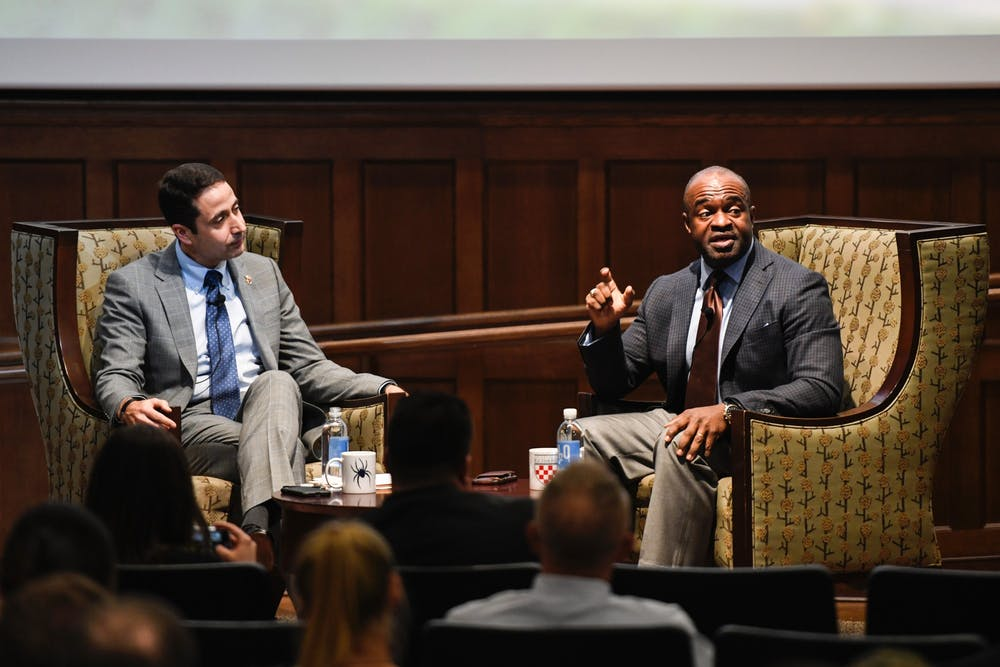 <p>DeMaurice Smith (right), executive director of the National Football League Players Association, spoke on Tuesday, Oct. 29, 2019 at the E. Claiborne Robins School of Business.&nbsp;</p>