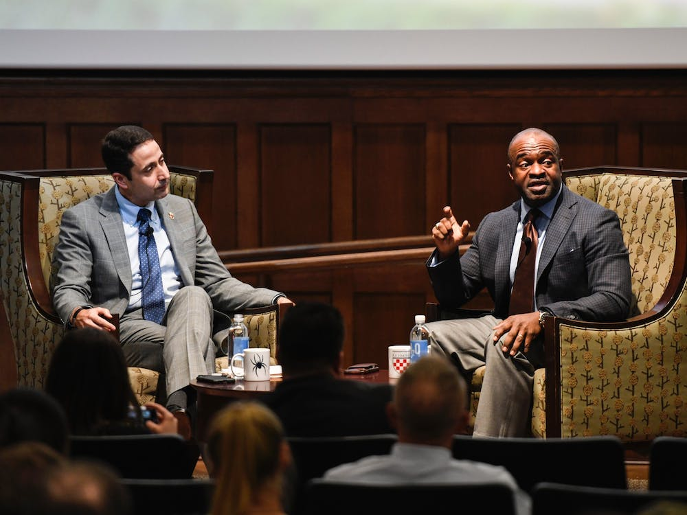 DeMaurice Smith (right), executive director of the National Football League Players Association, spoke on Tuesday, Oct. 29, 2019 at the E. Claiborne Robins School of Business.