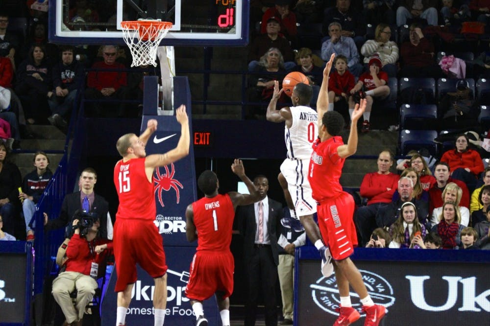 <p>Richmond point guard Kendall Anthony goes for a layup against three Radford defenders.</p>