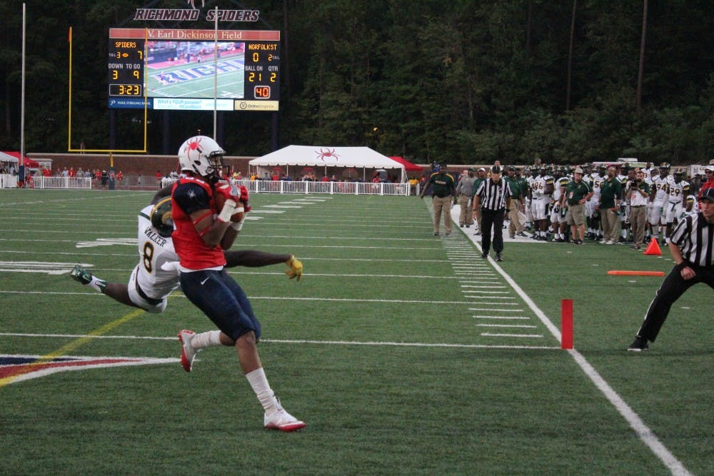 <p>Tyler Wilkins secures a 32-yard pass for a touchdown at the end of the second quarter.&nbsp;</p>