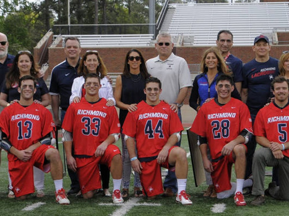 Seniors, their families and coaches pose for a senior day picture. Photo courtesy of Richmond Athletics.