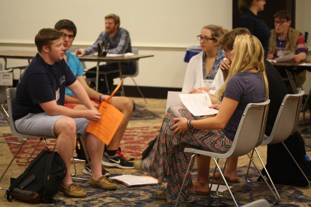 <p>Students discuss their thoughts on the Poverty Simulation in the Alice Haynes Room. Photo by Anna Cable.</p>