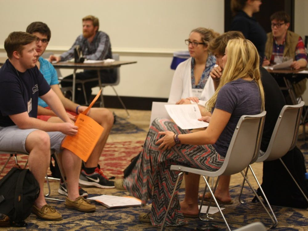 Students discuss their thoughts on the Poverty Simulation in the Alice Haynes Room. Photo by Anna Cable.