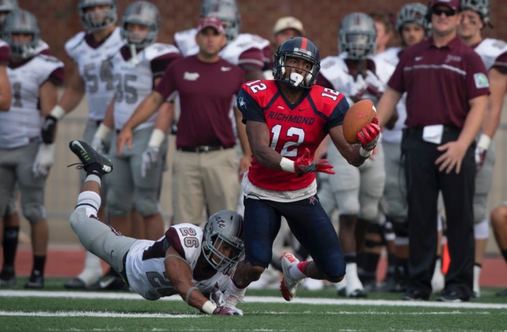 <p>Brian Brown reaches for a pass during Richmond's win over Colgate earlier this season.&nbsp;</p>