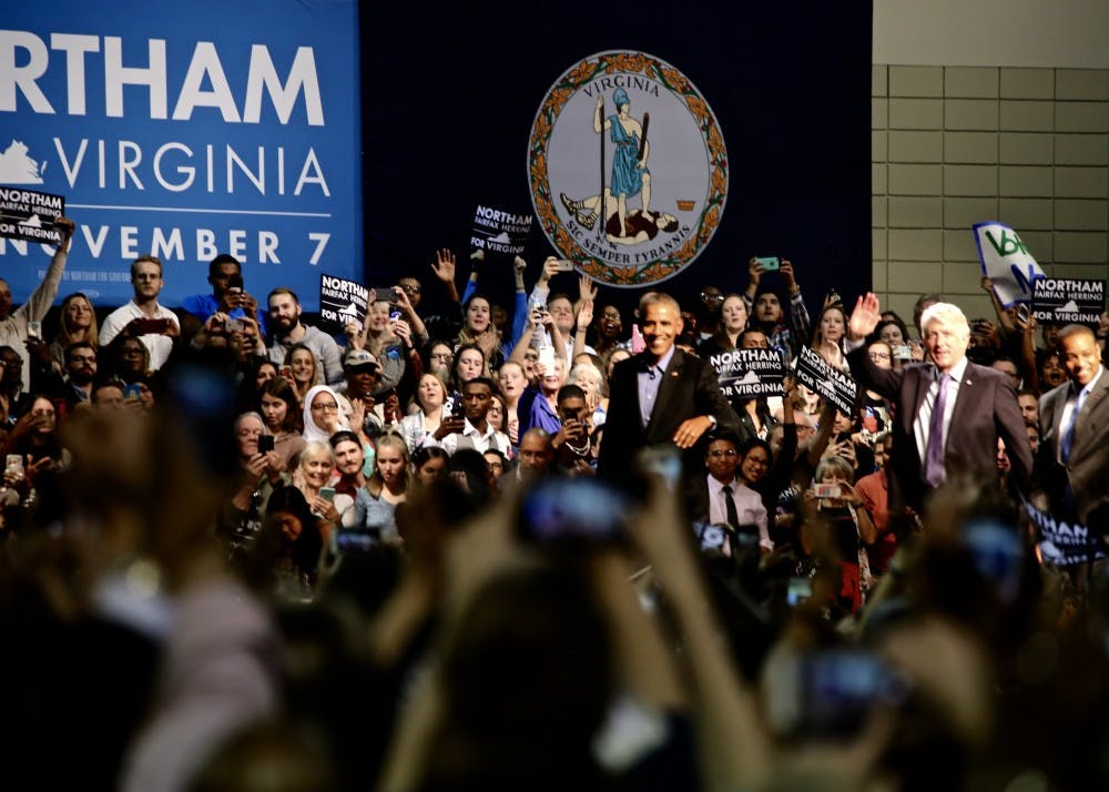 <p>A cheering crowd welcomes former President Barack Obama at the Richmond Convention Center during a rally for&nbsp;Ralph Northam, Democratic&nbsp;gubernatorial candidate.&nbsp;<em>Photo by Erin Moon.</em></p>