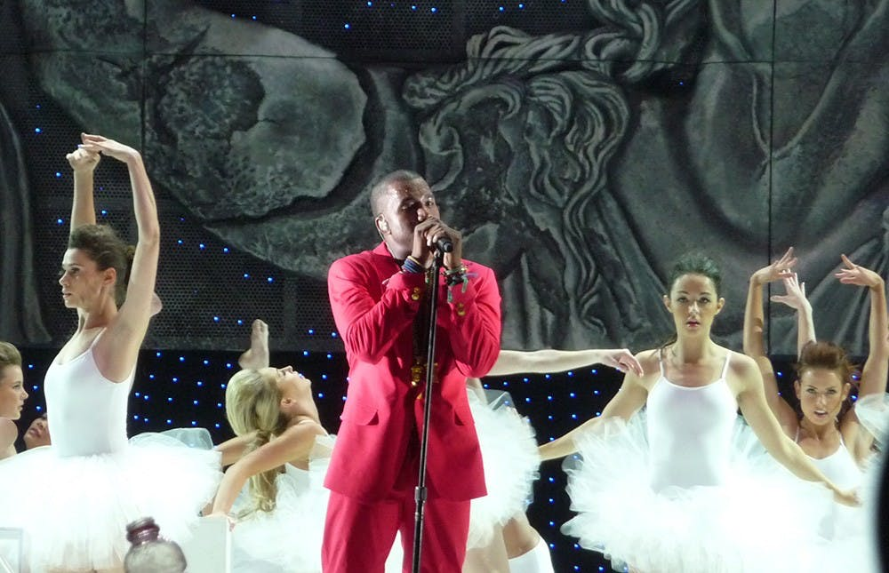 <p>Rapper Kayne West preforms at Coachella Valley Music and Arts Festival in 2011.</p>