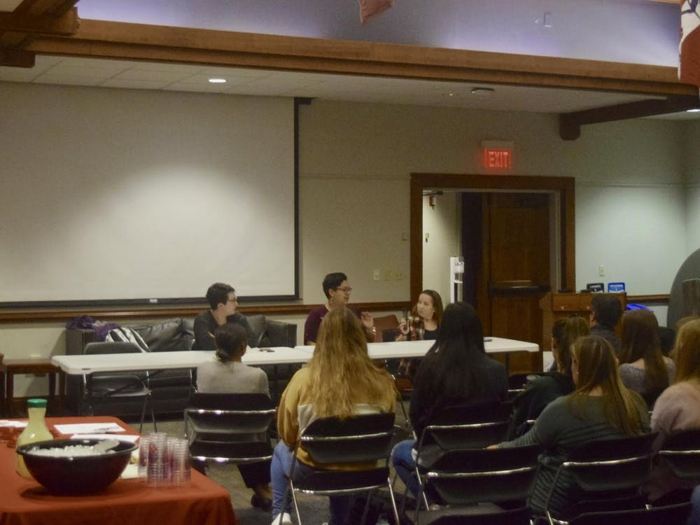 Students sit for a disability awareness panel.