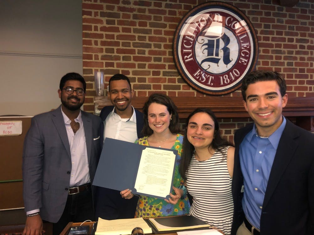 <p>The signing of the joint resolution with Senator Aquilla Maliyekkal (left), junior; RCSGA President Tyler York, senior; WCGA President Monica Stack, senior; Senator Caroline Schiavo, junior; and Senator AJ Polcari, sophomore. <em>Photo courtesy of Kevin Villagomez</em></p>