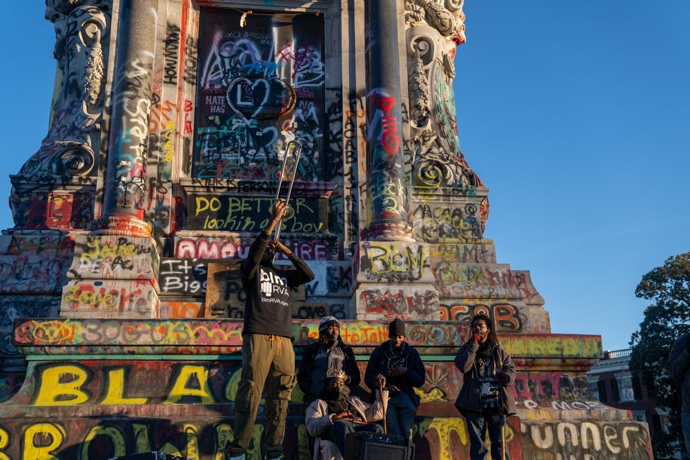 <p>Members of BLMRVA perform jazz on the Robert E. Lee Statue in, what is now known as, Marcus David Peters Circle on Jan. 20.</p>