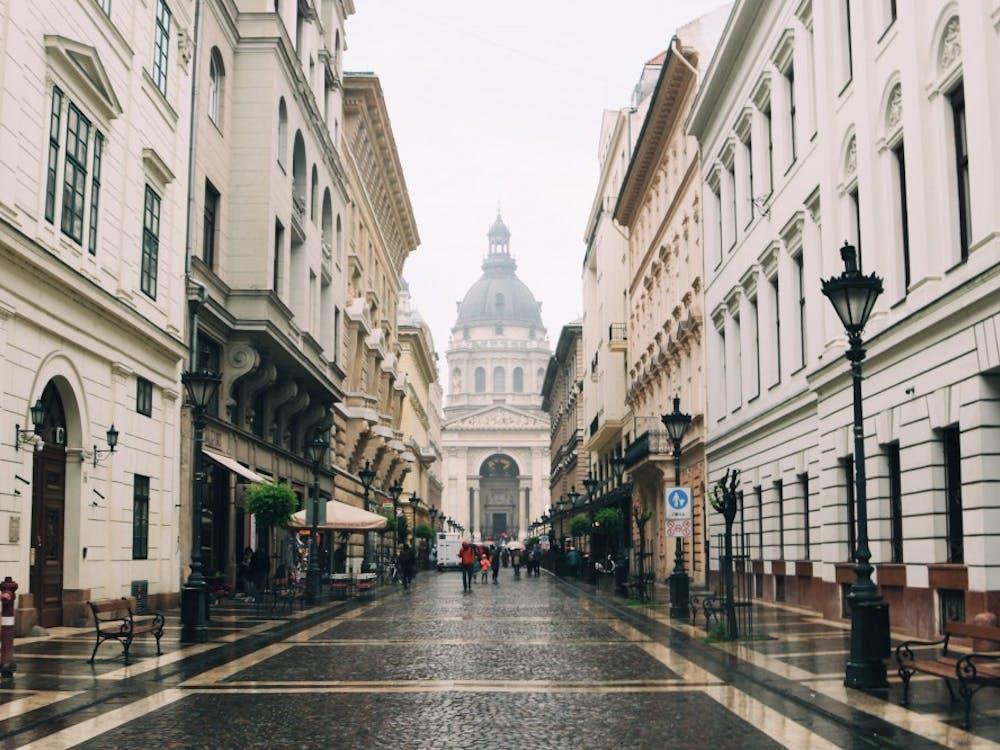 On Szent István tér, a brick square, walking toward Szent István Bazilika in Budapest, Hungary.