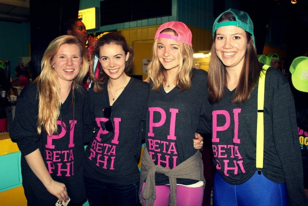 <p>Current USAID appointee Merritt Corrigan, second from left, seen with other members of the Virginia Eta chapter of Pi Beta Phi in 2013 during her time at UR.<em>&nbsp;</em></p>