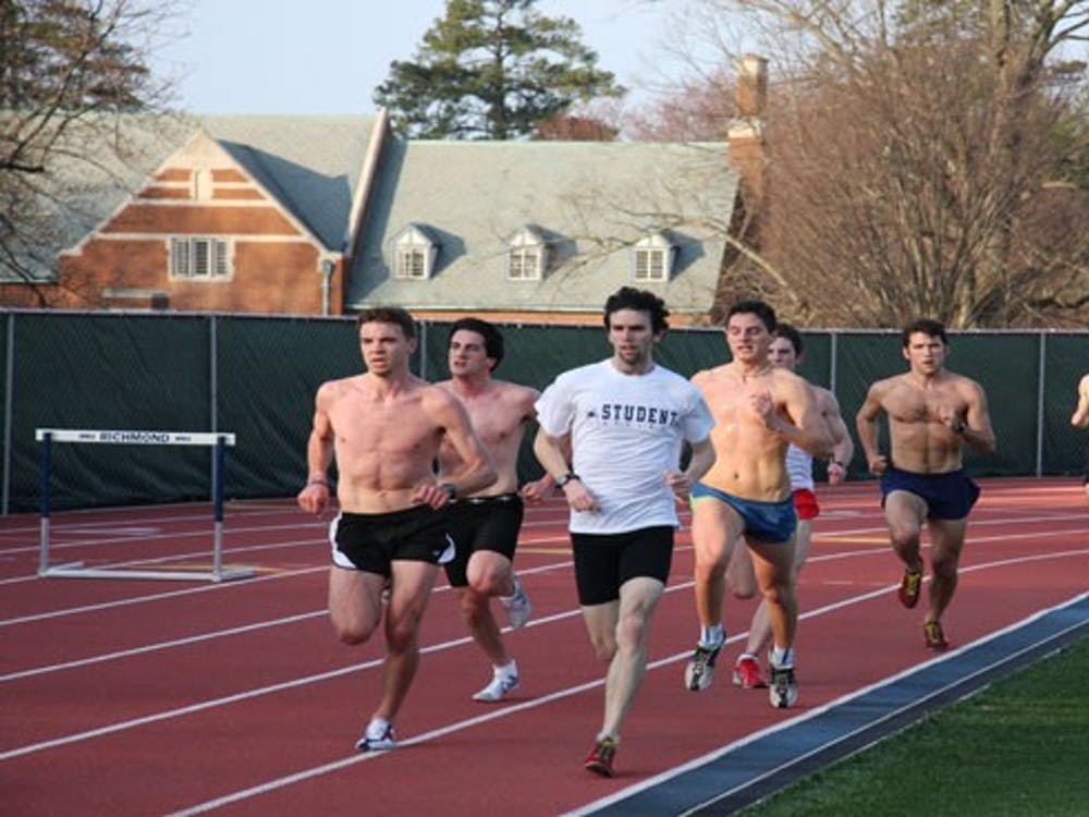 Members of the men's track team with Jeff Strojny, '09 and Sean Welsh, '09 in the lead