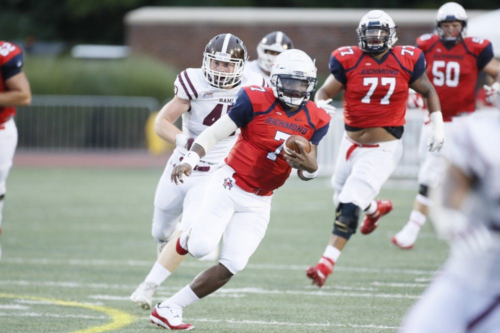 <p>Spider quarterback and junior&nbsp;Kevin Johnson (7) runs for a touchdown against&nbsp;Fordham Saturday night in the UR home opener.&nbsp;</p>