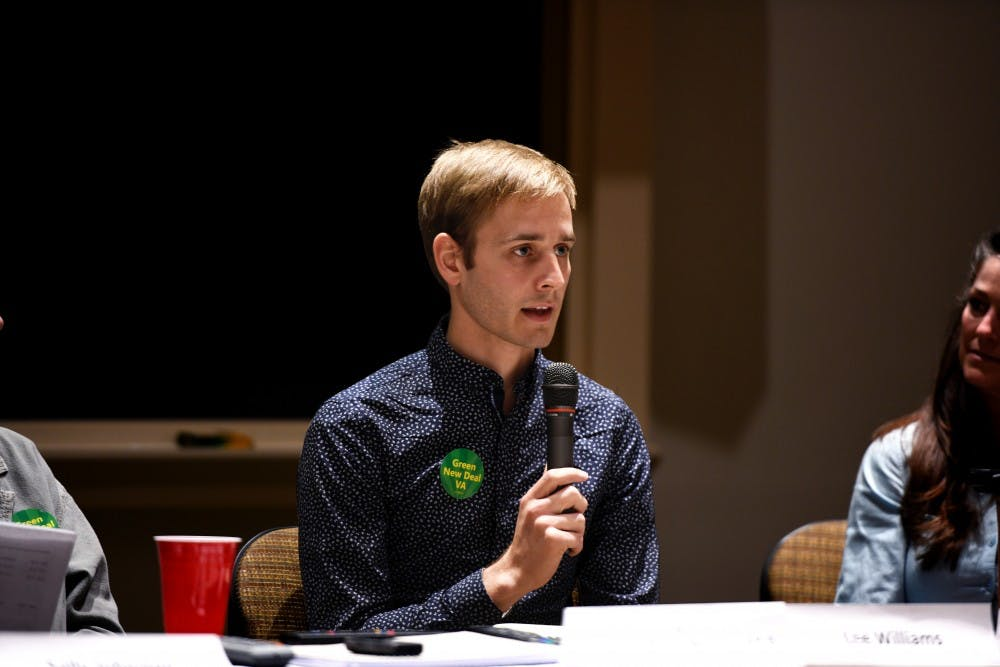 <p>Avery Lamb, a federal policy associate for Interfaith Power and Light, speaks at the panel event.</p>