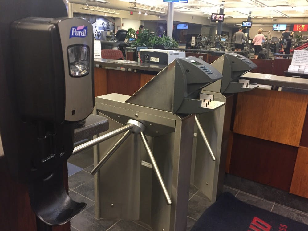 <p>The hand scanner at the entrance to the gym showed cautious levels of bacteria&nbsp;after a Nov. 10 test. A Purell dispenser has since been placed near the scanners.</p>