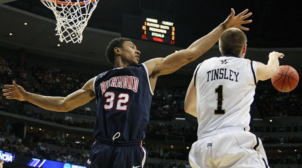 University of Richmond senior Justin Harper goes to block a shot during the second-round NCAA men's basketball tournament game at Pepsi Center in Denver on Thursday, March 17, 2011. (Anna Kuta/The Collegian)
