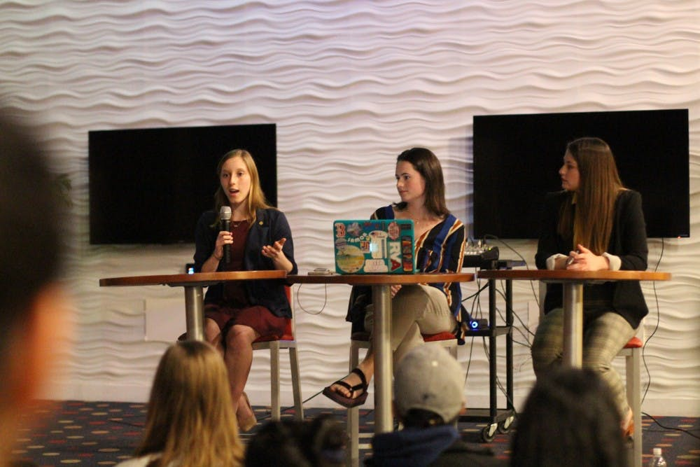 <p>Candidate Lindsey Paul (left), current WCGA president Monica Stack and candidate Claire Tate participate in a debate preceding the WCGA presidential election.</p>
