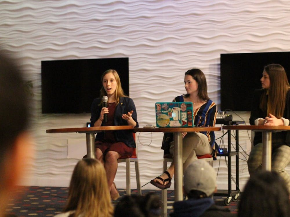 Candidate Lindsey Paul (left), current WCGA president Monica Stack and candidate Claire Tate participate in a debate preceding the WCGA presidential election.