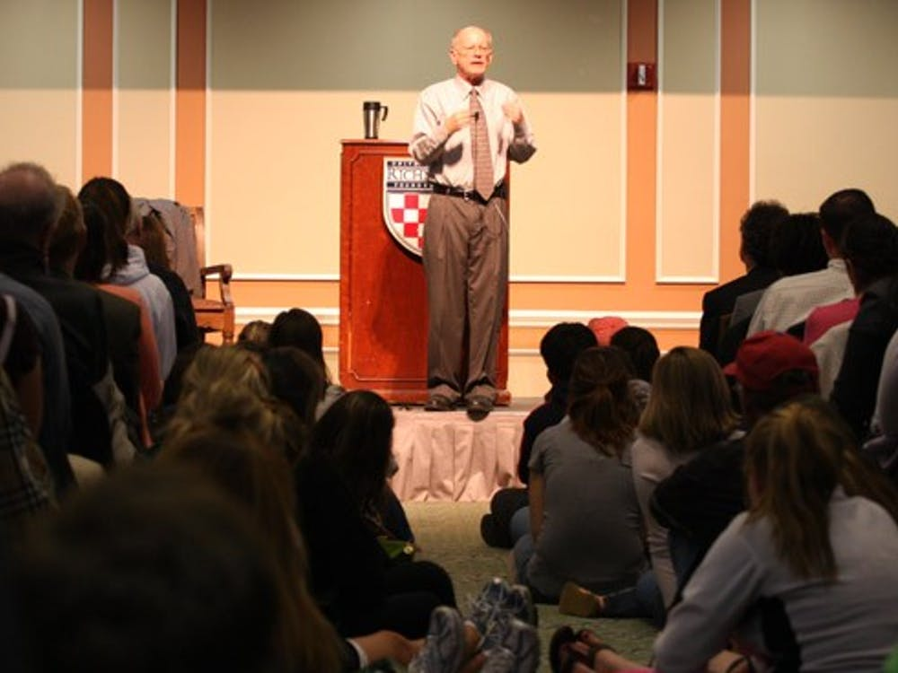Joe Hoyle speaks in a room filled to capacity in the Jepson Alumni Center