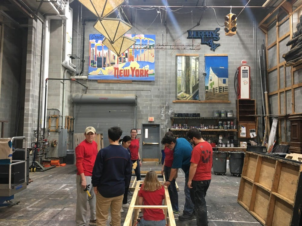 Phil Hayes, assistant technical director and scene shop foreman for the UR department of theatre and dance, works with students on designing a set.