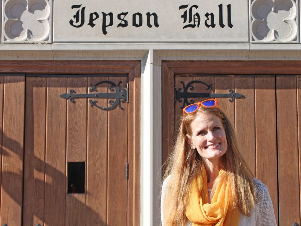 Crystal Hoyt stands in front of Jepson School of Leadership Studies.