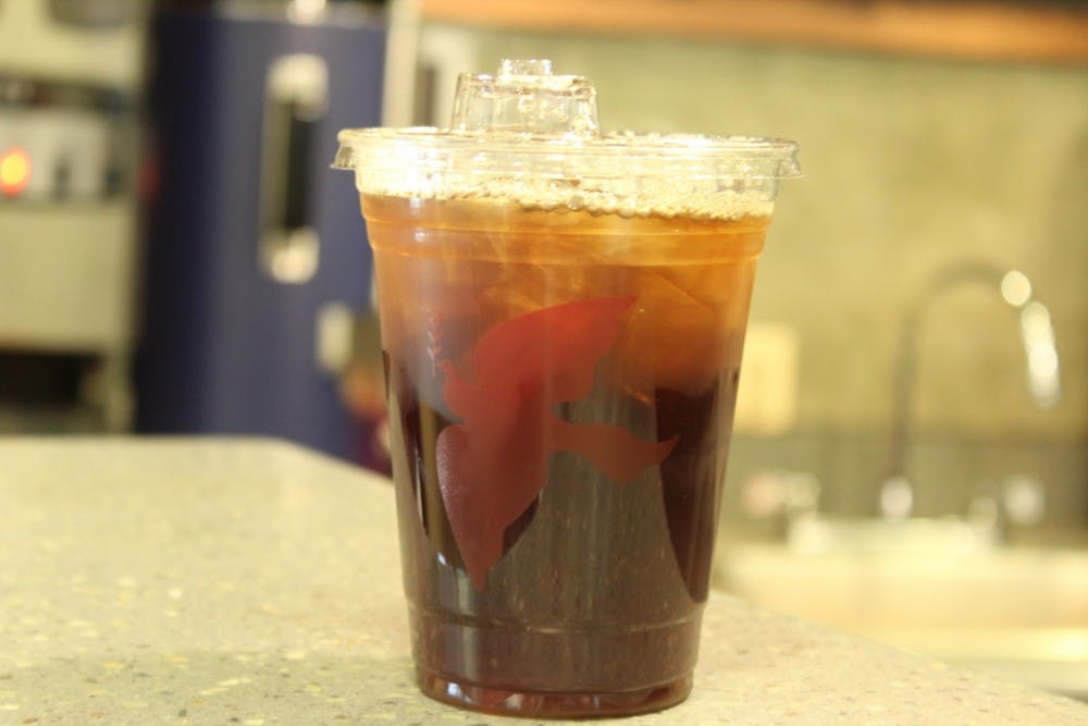<p>An iced La Colombe coffee sits on the counter for pickup.</p>