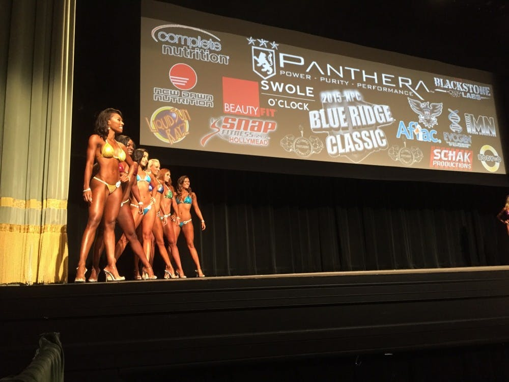 Bikini contestants lined up along the sides of the stage before being called into the center to pose for the judges.