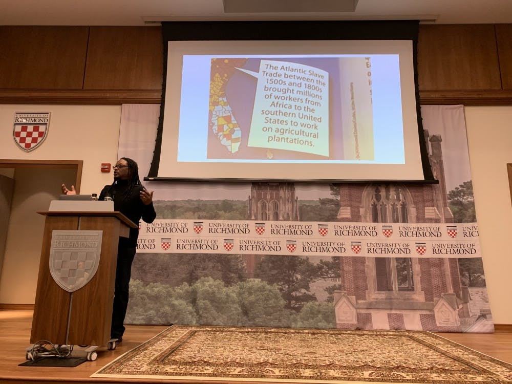 """<p>Lawrence Ross speaks to the audience at his lecture on his book """"Blackballed: The Black and White Politics of Race on America's Campuses.""""</p>"""