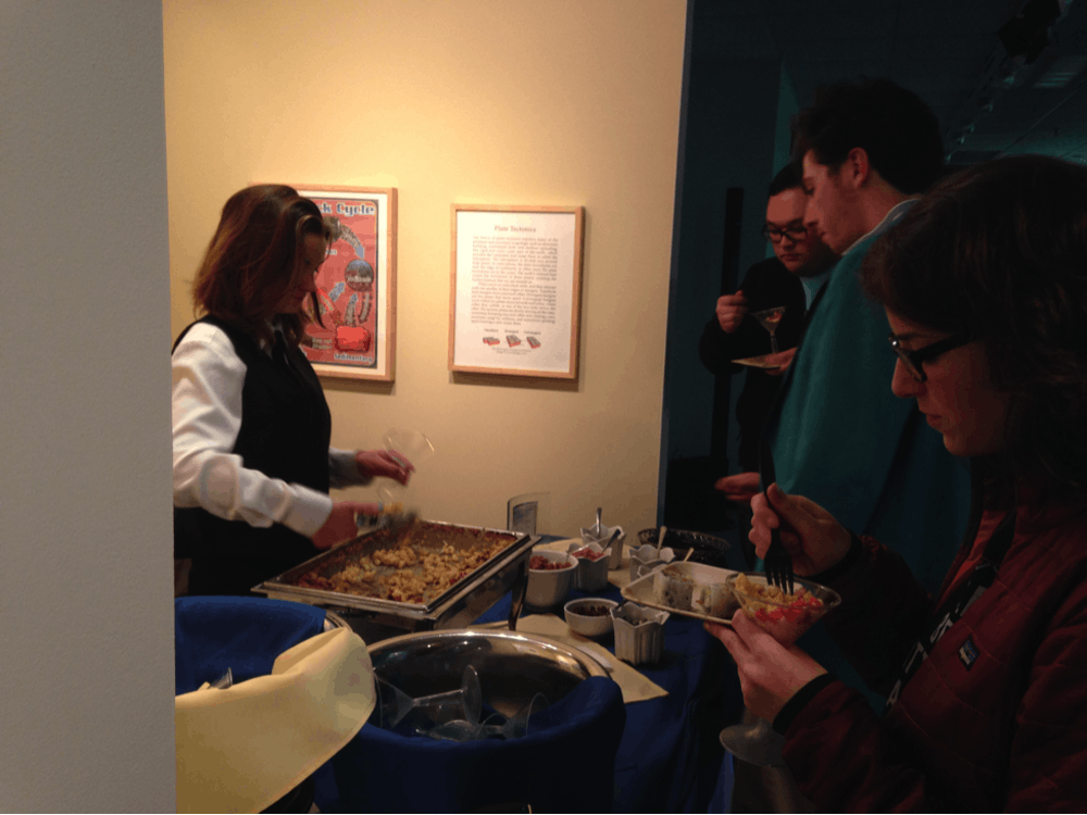 Students gather around the macaroni and cheese bar.