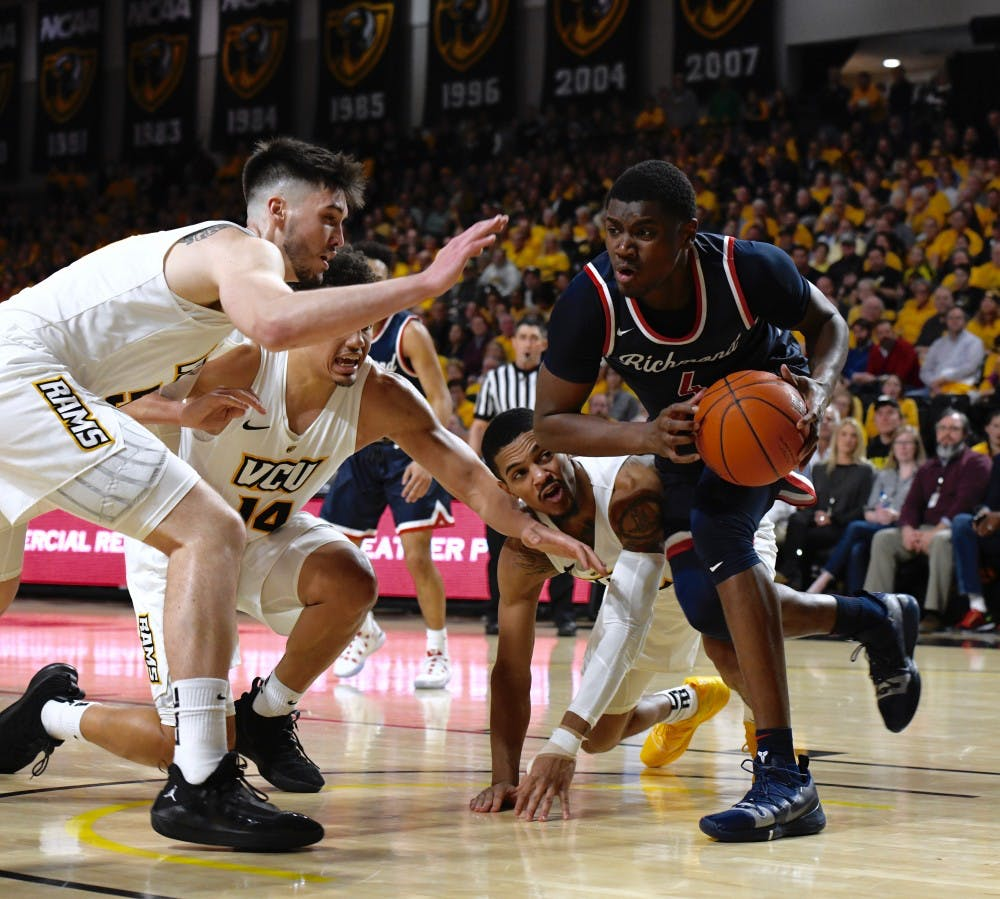 <p>Sophomore forward Nathan Cayo runs past the VCU defense at the Siegel Center on Wednesday, Feb. 13.</p>
