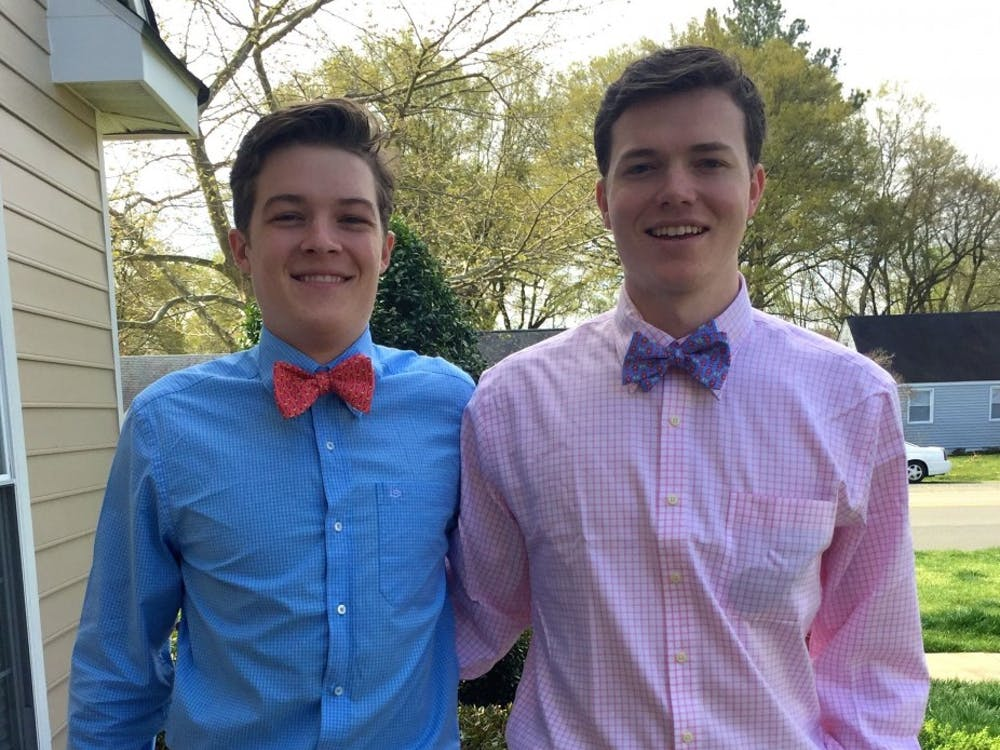 Dylan Herman and Roger Coleman coordinated their Pig Roast outfits with bowties and button-down shirts.