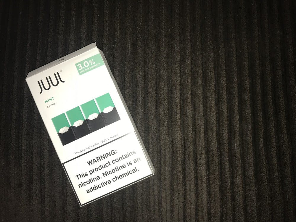 <p>A carton of mint-flavored Juul pods.</p>