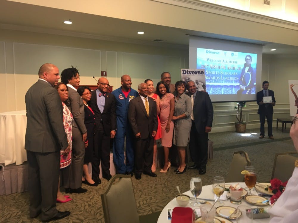 <p>Leland Melvin, pictured above&nbsp;in his blue NASA uniform, stands with Dr. Ronald and Betty Crutcher, along with representatives from the&nbsp;NCAA and Diverse Magazine.&nbsp;</p>