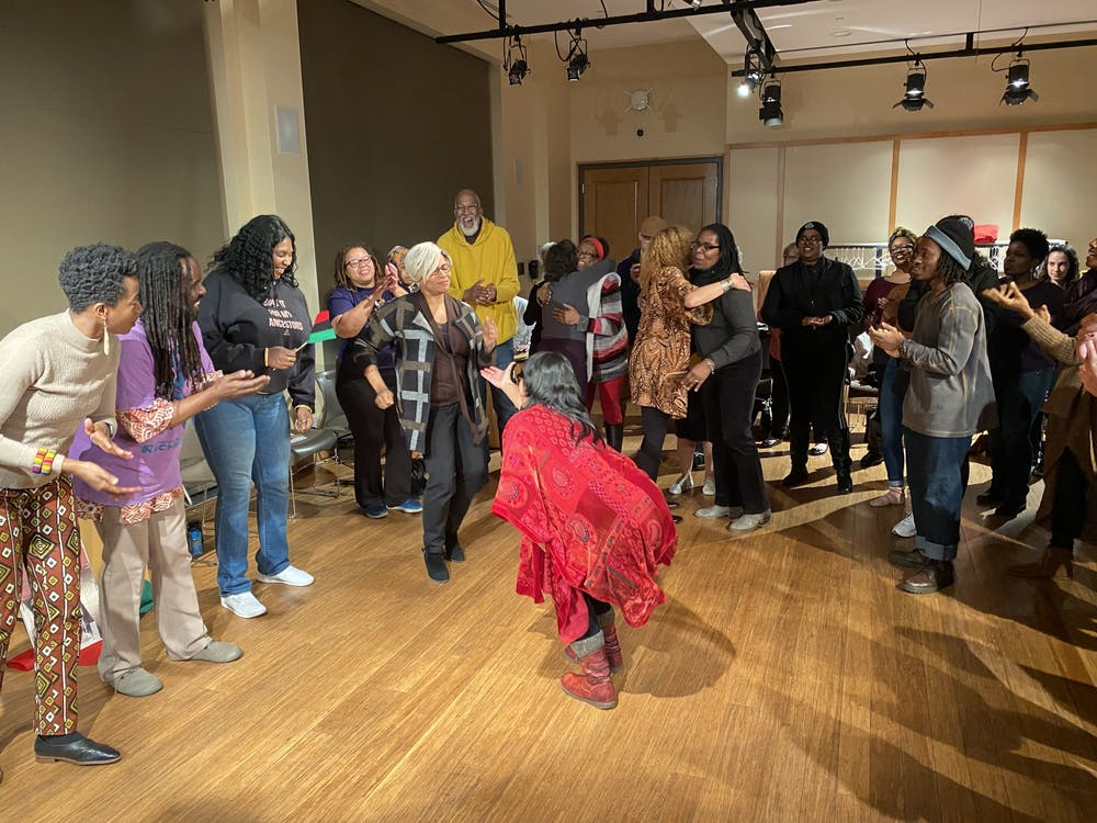 <p><em>Left to right: Speakers MK Abadoo, Kevin Lamarr Jones and Free Bangura watch as Professor Alicia Díaz encourages Lauranett Lee to dance for the crowd.</em></p>