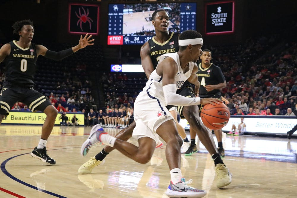 <p>Guard Blake Francis, a redshirt junior, stays focused against the Vanderbilt Commodores' defense during the game on Thursday, Nov. 14, 2019.&nbsp;</p>