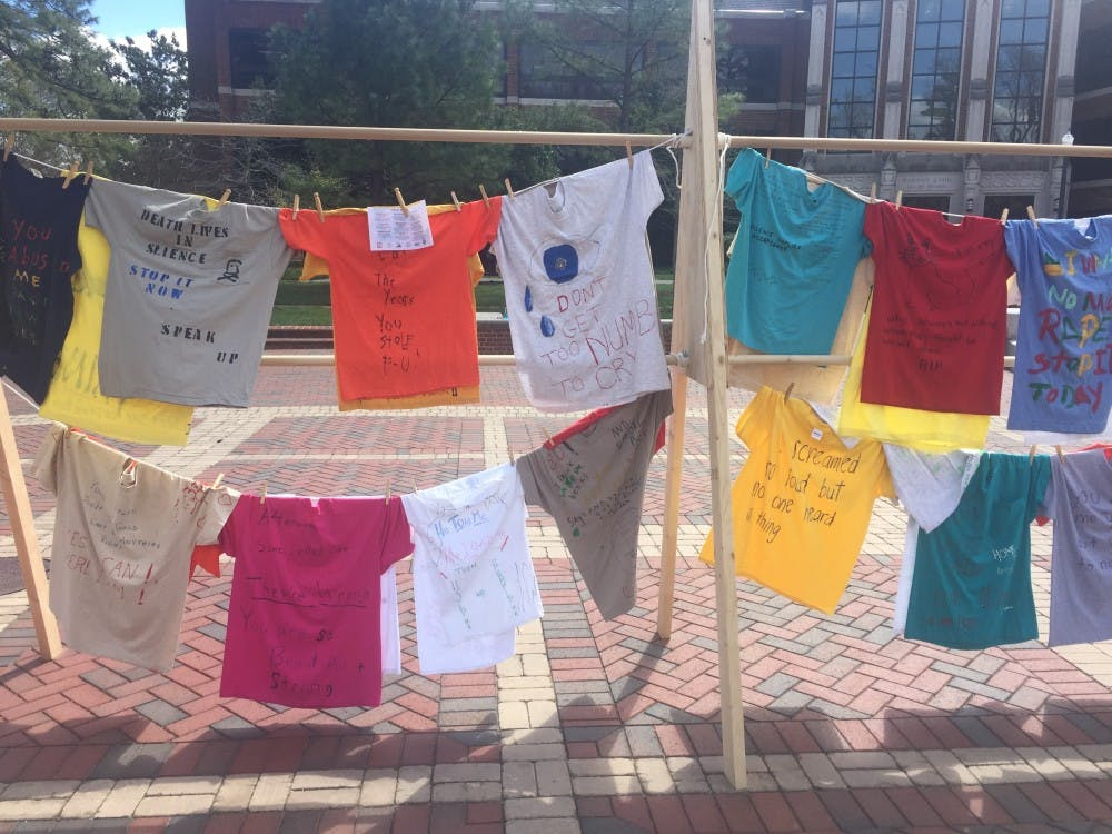 T-shirts on display in the Forum as part of the Clothesline Project.