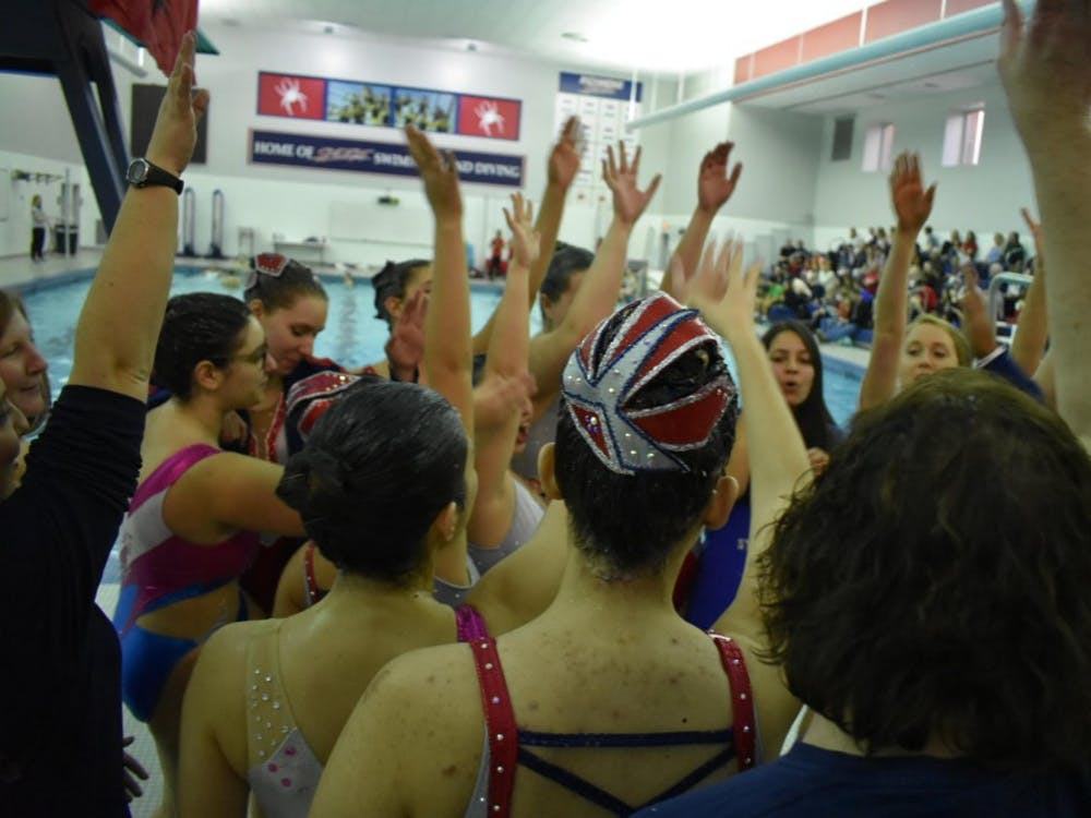 Both the current members and alumni of the synchronized swimming teamcame togetherbefore the competition to do the Spider cheer. Photo courtesy of coach Asha Bandal.