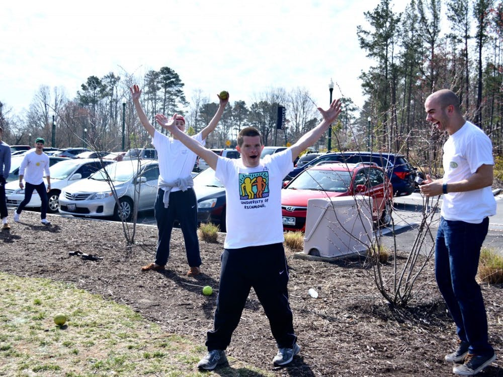 Will Daniel celebrates dunking Richmond student at the event.