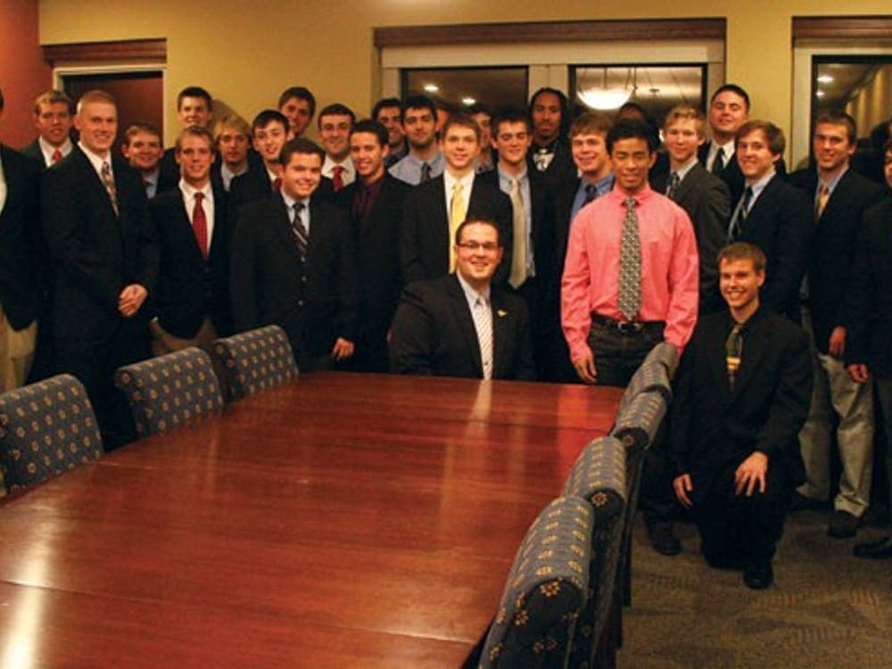 The 31 associate members of Lambda Chi Alpha, seen here with national representatives Matt Schultz and Patrick Voldness, accepted bids during a ceremony Sunday night in the Tyler Haynes Commons.