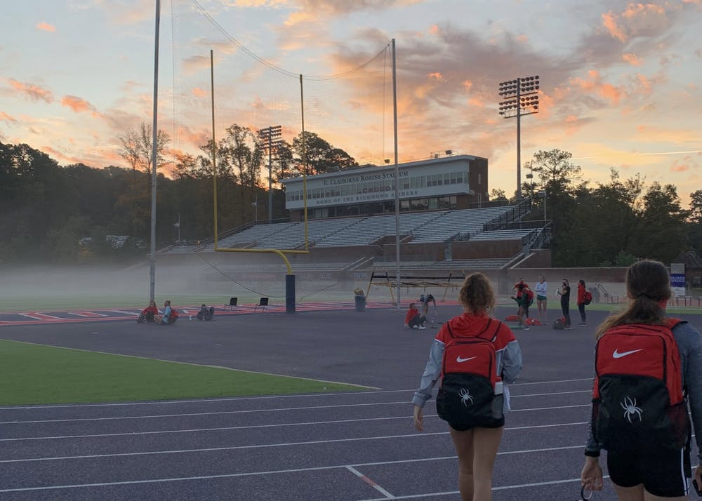 <p>Members on the women's cross country team walk to an early morning practice. <em>Courtesy of Anna George</em></p>