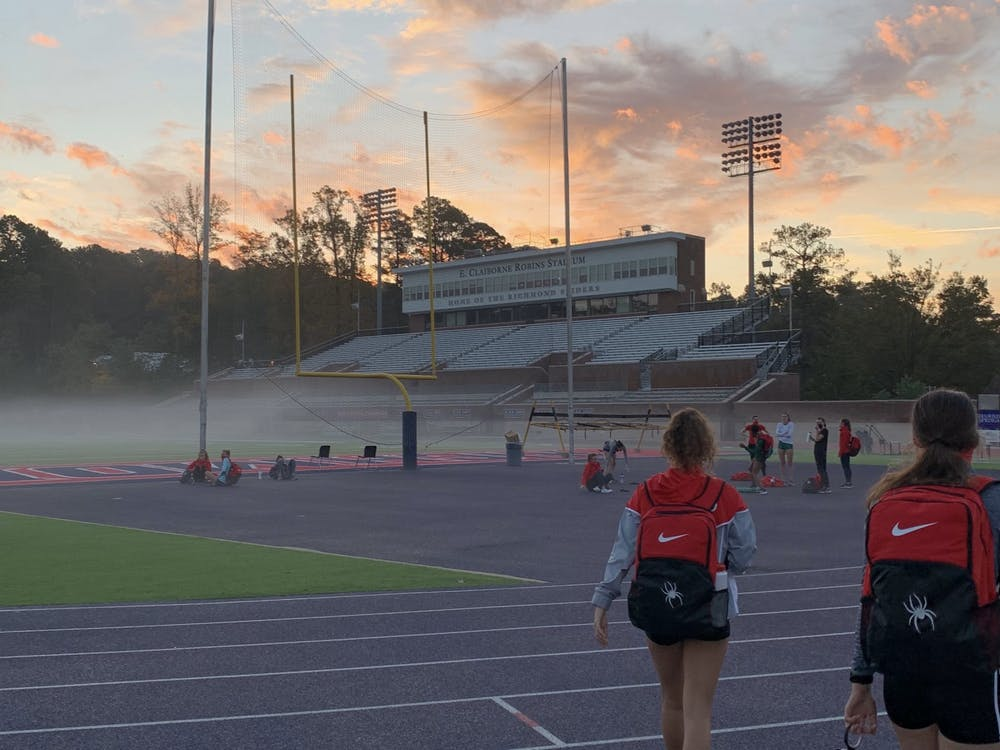 Members on the women's cross country team walk to an early morning practice. Courtesy of Anna George