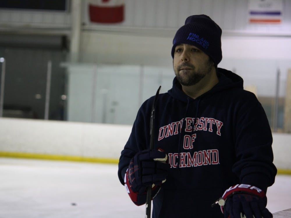 Jason Block, Richmond club hockey's new head coach, watches the team practice drills at SkateNation Plus.