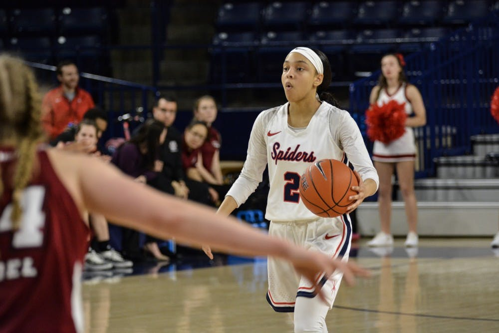 <p>Junior guard Aniyah Carpenter take the ball in 62-58 win over UMass in February 2019.&nbsp;</p>