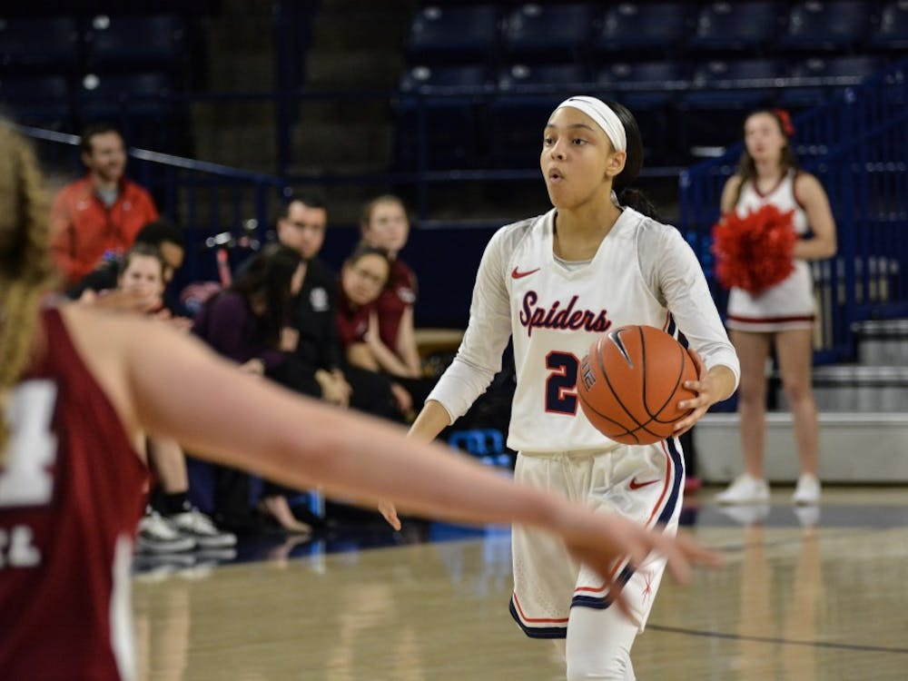 Junior guard Aniyah Carpenter take the ball in 62-58 win over UMass in February 2019.
