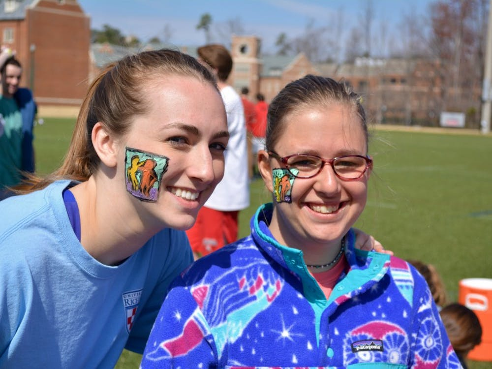 Sophomore Emma Thomas (left)and her buddy Adeline show off their Best Buddies facepaint.