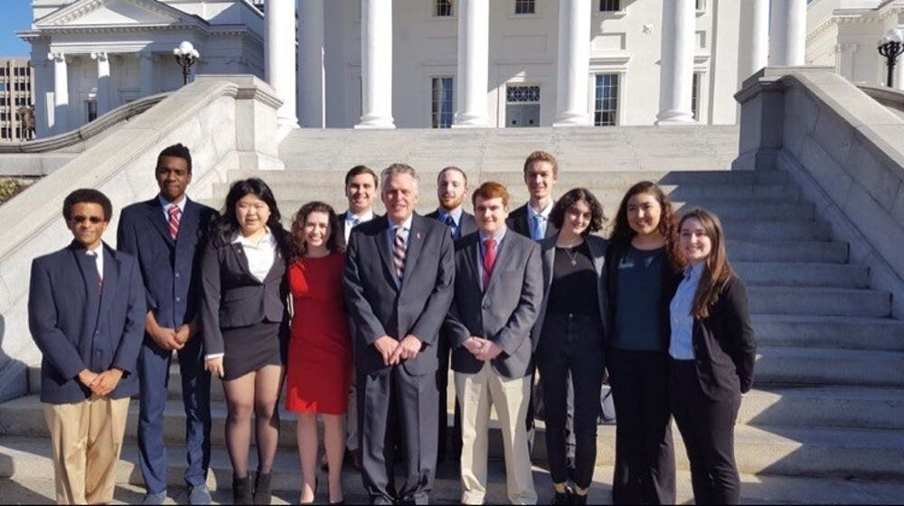<p>Members of the College Democrats pictured with Governor of Virginia Terry McAuliffe in January 2017. Photo courtesy of Hunter Moyler.&nbsp;</p>