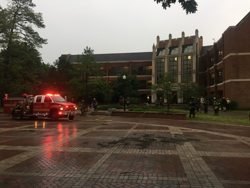 <p>Fire fighters outside Gottwald Center for the Sciences after a fire broke out on the third floor on Wednesday evening.</p>